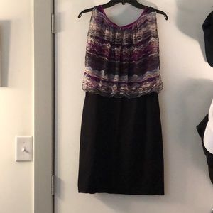 Black dress with color top.